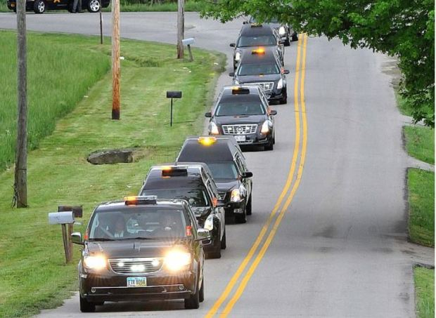funeral procession for ffive members of the Rhoden family.JPG