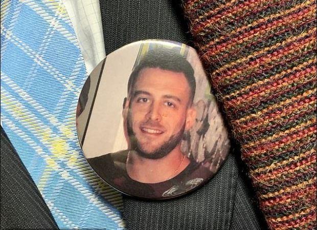 Joseph Comunale's friend wears his image as a button 1.JPG