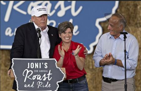 Donld trump, [left], Senator Joni Ernst [center] and her husband Gail Ernst [right] 1