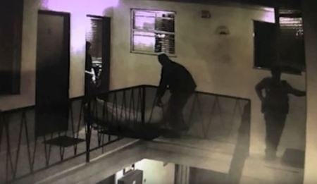 Gemmel Moore's body is removed from Edward Buck's apt 1