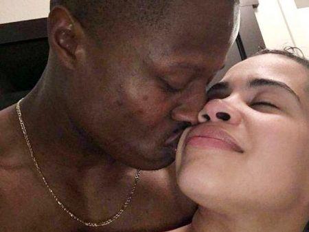 Kandou Worley (left) kissing Stephanie Gallardo 1