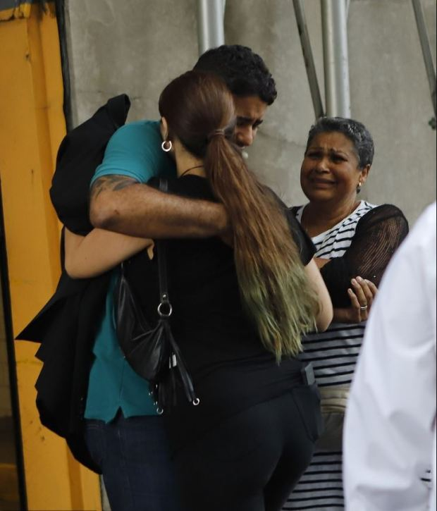 Juan Rodriguez embraces his wife after he is released from custody 4