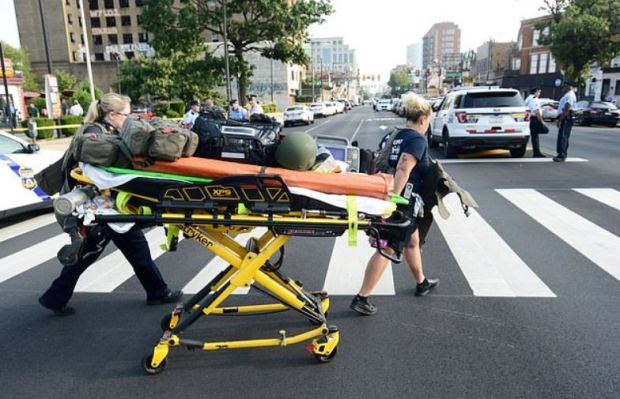 Injured Philly cop is transported to hospital 1.JPG