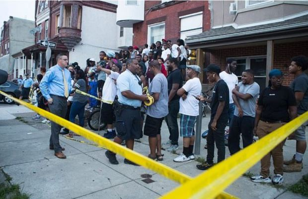 Philadelphia crowd watch police after six officers were injured during Sept 14 shooting 2