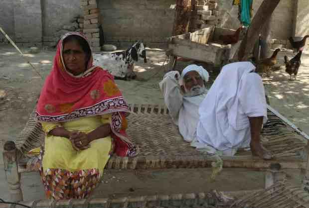 Quandeel Baloch's parents Anwar and Muhammad Azeem at home in Shah Sadar Din in Punjab.jpg