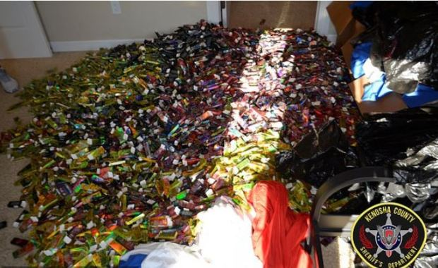 Pile of empty vape catridges recovered when police raided theHuffhines condo which was used to run a rude assembly line filling the cartridges with THC 1