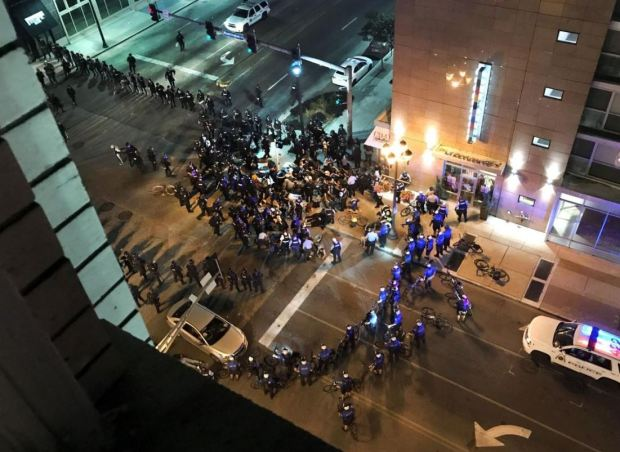 Police in St Louis use 'Kettling' technique to block in protesters and arrest them enmasse on Sept 17, 2017