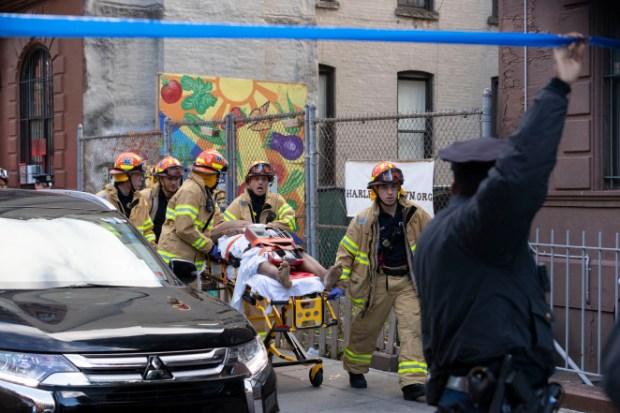 EMTs evacuate bodies from homicide scene in Harlem, NY on Friday Oct 18 2.jpg