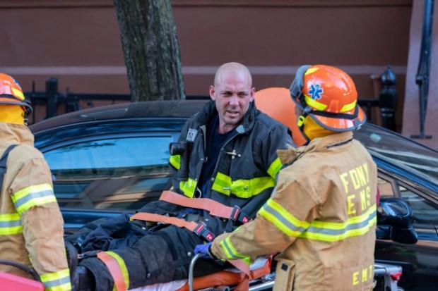 EMTs evacuate injured fireman from homicide scene in Harlem, NY on Friday Oct 18 3.jpg