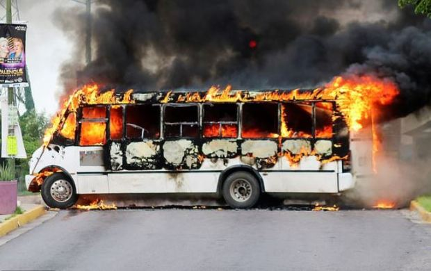 Sinaloa Cartel gunmen block streets in Culiacan with burning vehicles 1.JPG