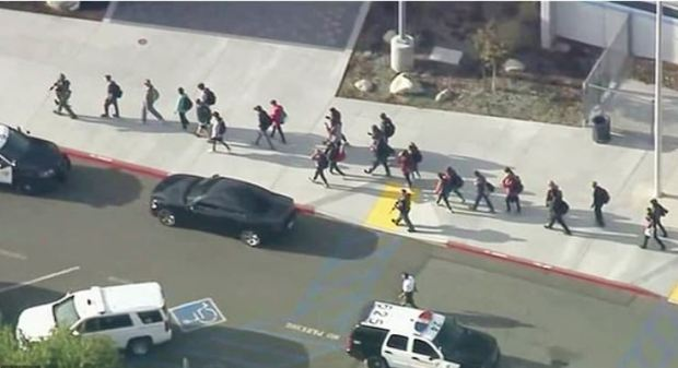 Armed police officers evacuate students after California school shooting on Nov 14, 2019 1.JPG