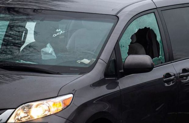 Bullet riddled van in the parking lot of Sarah J. Anderson Elementary School in Hazel Dell following the shooting on Nov. 26, 2019.JPG