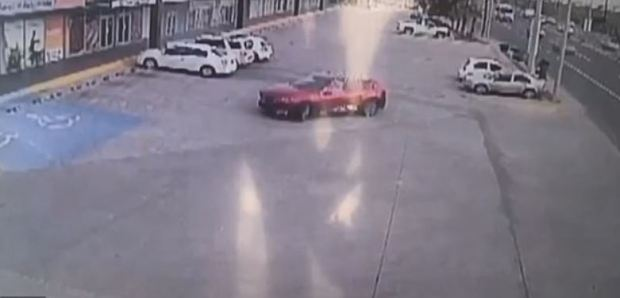 CCTV captured the scene in which the Sinaloa cartel gunmen drove up to the white Nissan in a red car.JPG