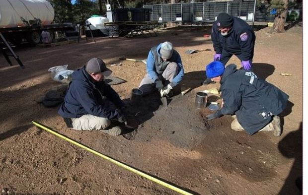 Investigators are seen working at the site of the burn scar in the earth at Patrick Frazee's ranch.JPG