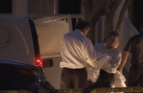 Police remove body from Todt family home in Osecola, Florida.png