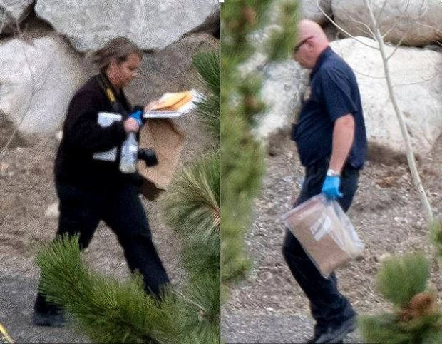 Cops carry evidence bags and equipment into the Morphews home just outside Salida, Colorado 1