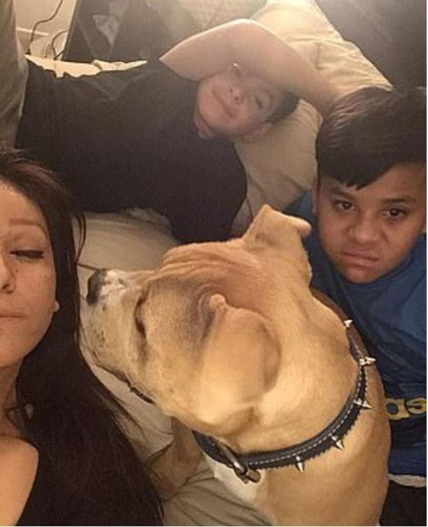 Erlinda Villareal, 42 (left), and her sons 3