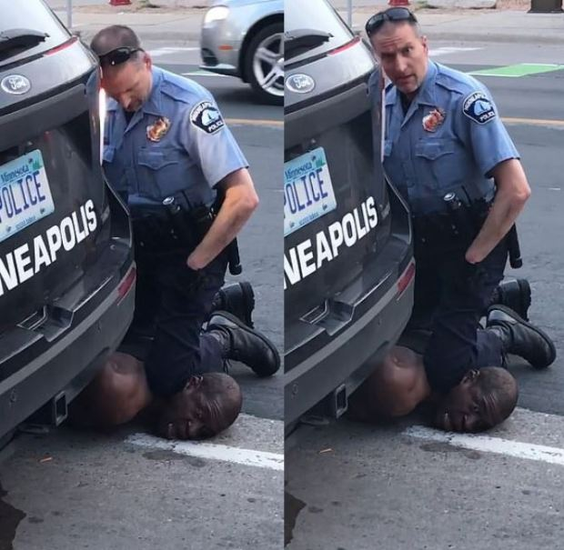 White Minneapolis police officer pins  a black man to the ground with his knees 1