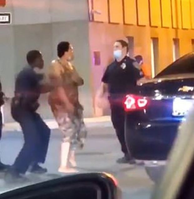 Cop knocks woman out in Baltimore 6