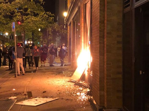 Protesters try to set fire in downtown Grand Rapids on Saturday