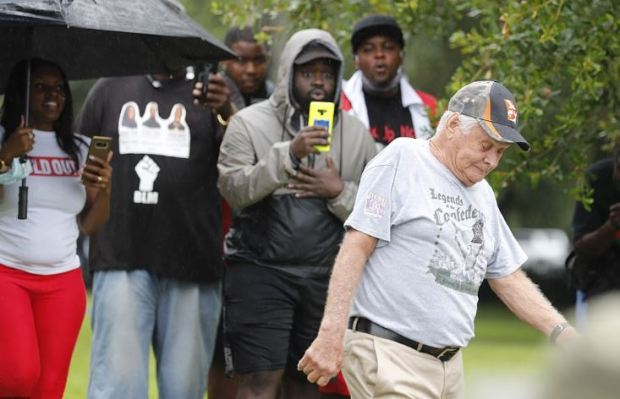 White man in confederacy short walks past Justice 4 Ahmuad Arbery protesters 1
