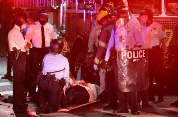 This image has an empty alt attribute; its file name is Police-officer-injured-during-protests-in-Phladelphia-Oct-26-after-police-shot-and-killed-Walter-Wallace-1.jpg