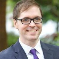 ULM professor Joshua Comer, 39, dead, 'shot by his father-in-law, 68, in murder-suicide', in the home they all shared, with both wives present