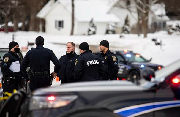 This image has an empty alt attribute; its file name is Police-activity-after-the-murders-of-Gary-and-Laura-Johnson-at-their-home-in-Portage-Michigan-1.jpg