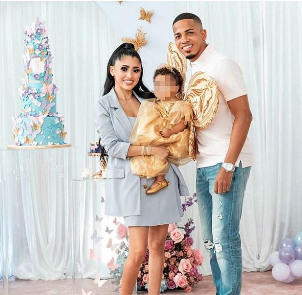 This image has an empty alt attribute; its file name is Felix-Verdejo-Sanchez-left-with-his-wife-Eliz-Marie-Santiago-and-their-daughter-1.jpg