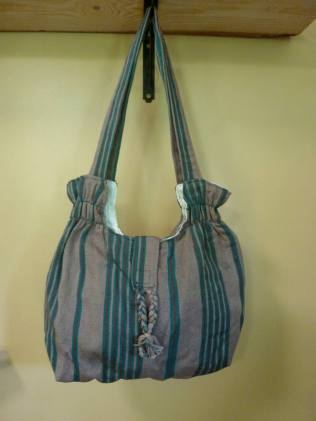 """$30.00 Measure: 10""""H x 11.5"""" W with a 22"""" Strap. Outer velcro closure with an inside zipper pocket. Hand washable. Amount available: 1 unit From San Juan la Laguna, Sololá. Woven by Tz'utujil-Maya women, of Asociación Comunitaria Ixoq Ajkeem. Products are made with natural dyes with the women themselves staining the raw threads with colors extracted from carrots, allspice, fuchsia, annatto seed, avocado leaves, sacatinta, hilamo, guachipilin, and St. John's Wort among others."""