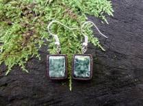 $16.00 Amount Available: 1 These earrings are made out of marble inset in clay with hooks of alpaca (a mix of zinc, copper and nickel).
