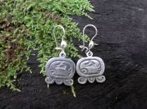 """Maya Nawal Glyph """" Kej """" Earrings $45.00 Amount Available: 1 The glyph represents a closed hand with opposing fingers; closing off a circuit of energies that charges the four cardinal points which are represented by the four fingers on the right and charged by the opposing finger. Signifies the deer and the horse; it is the four pillars that sustain the sky and the earth; the force and the powers that charge the destiny of humanity; realization of the physical existence; food; the power of complementation; the wind that passes; the guardian of the forests."""