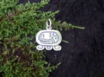 """Maya Nawal Glyph """" E """" Pendant $30.00 Amount Available: 1 On the upper right side are the ears which signify the path; the curves and the points are the stones placed on the side of the path and the steps on a stairway. E symbolizes the path of destiny, which means more of the path than you are able to see with your eyes; because it is the path of life, the guide, the one that takes us to a precise objective point."""