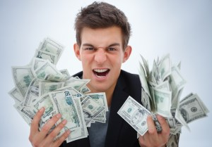 Closeup of a young business man holding money