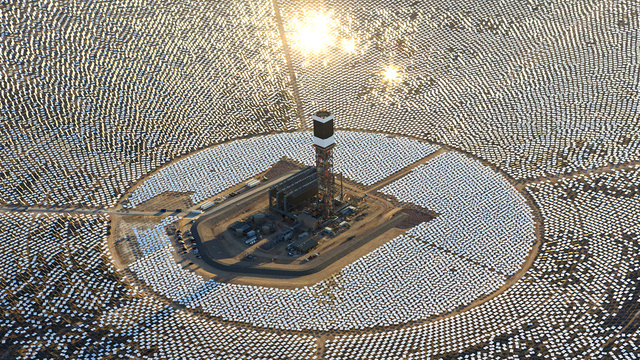 IVANPAH, CALIFORNIA, APRIL 05 2013: An aerial view of Tower 1 and its heliostats at  the Ivanpah Solar Power Facility. Tower 1's heliostast installation is nearly completed, and steam blow tests are taking place. Located in the Mojave Desert 40 miles southwest of Las Vegas, The Ivanpah Solar Power Facility is a solar thermal power project, currently under construction, with a planned capacity of 392 megawatts, enough to power approximately 140,000 houses. It will deploy 170,000 heliostat mirrors spread over 4,000 hectares, focusing solar energy on boilers located atop three solar power towers, generating steam to drive specially adapted steam turbines The project, developed by Bechtel, will cost $2.2 billion and be the largest solar farm in the world (photo Gilles Mingasson/Getty Images for Bechtel).