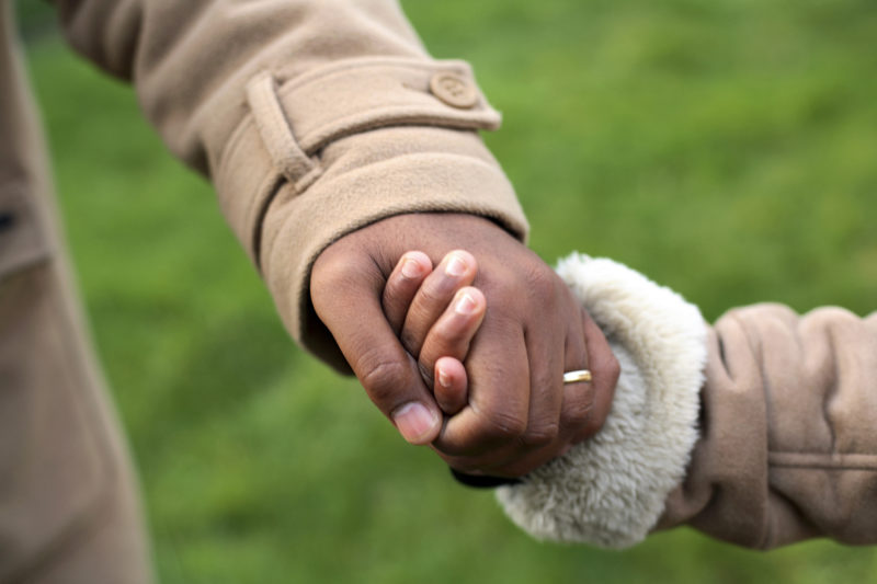 Child holding mother's hand. Custody of children is a sensitive issue, and rarely do children want to be separated from their parents.