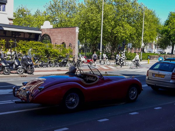 A red old timer cabriolet captured on the streets of Amsterdam West