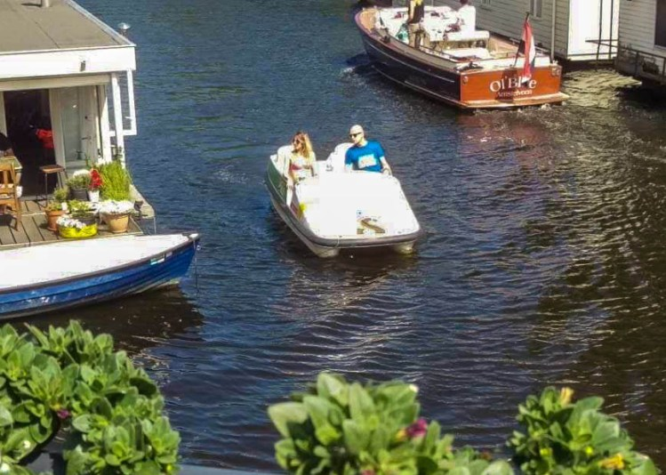Canal cruising nexto to house boats in Amsterdam