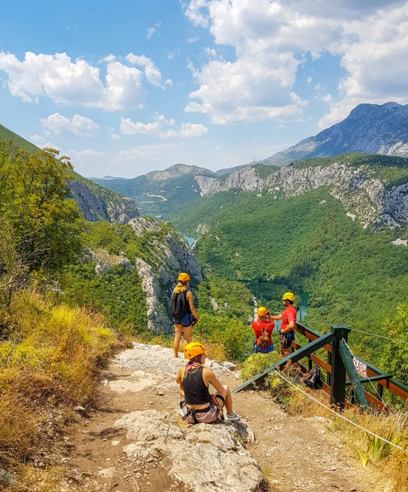 Waiting in line to do a Zipline looking towards the Cetina river and mountains