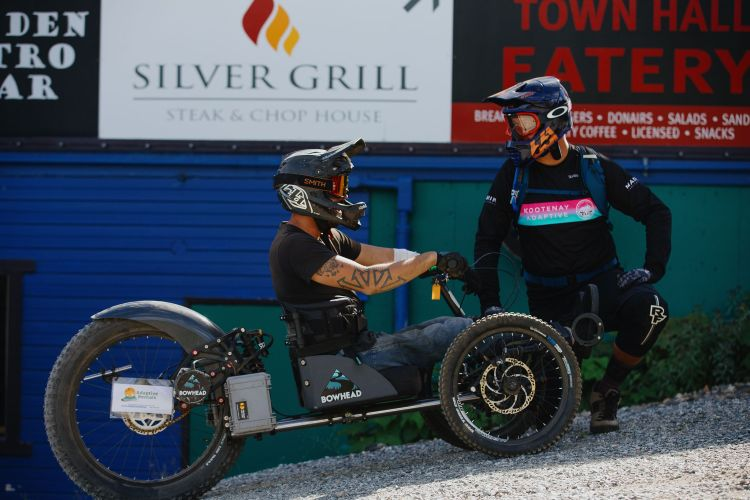 Kootenay Adaptive Instructor, working with an adaptive mountain biker who is riding a Bowhead Reach at Silverstar Mountain Resort