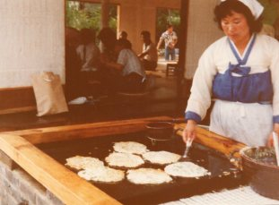 Grandma spotted what look like bindaetteok, or mung bean pancakes, but didn't mention eating them.