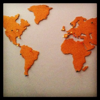 "Map of the world X-Acto cut from 1/4""-thick cork."