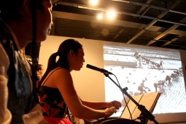 Jung Ji-eun plays her Kayageum composition while her father's photos are projected onto the screen