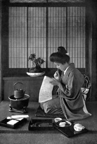 WRITING A LETTER In lotus-land Japan, 1910 by H.G.Ponting