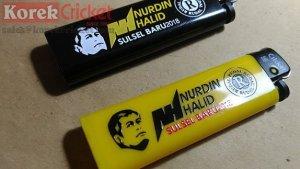 Korek Cricket warna hitam dan kuning sablon logo Nurdin Halid Sulawesi Selatan