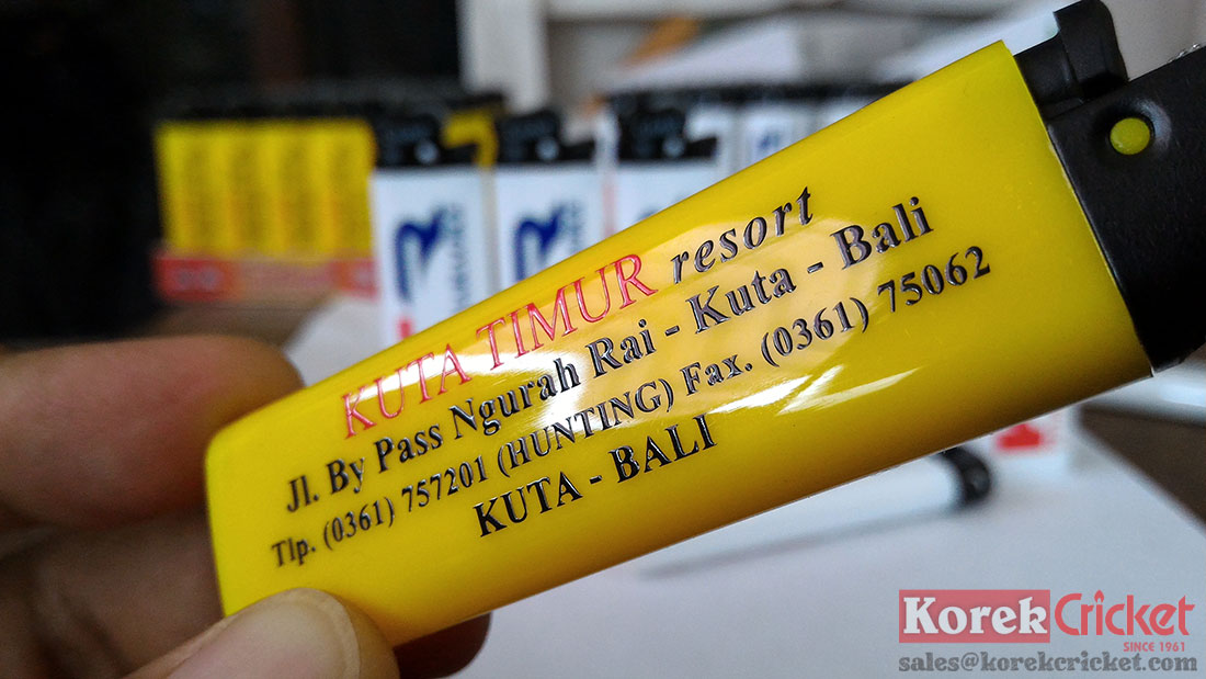 Korek api cricket warna kuning sablon logo kuta timur resort