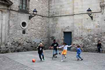 Children playing soccer in the streets of Barcelona, Spain.