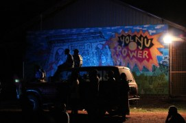 The local Yolngu people of North East Arnhem Land watch a gig from their basketball court, Yirrkala, 2012.