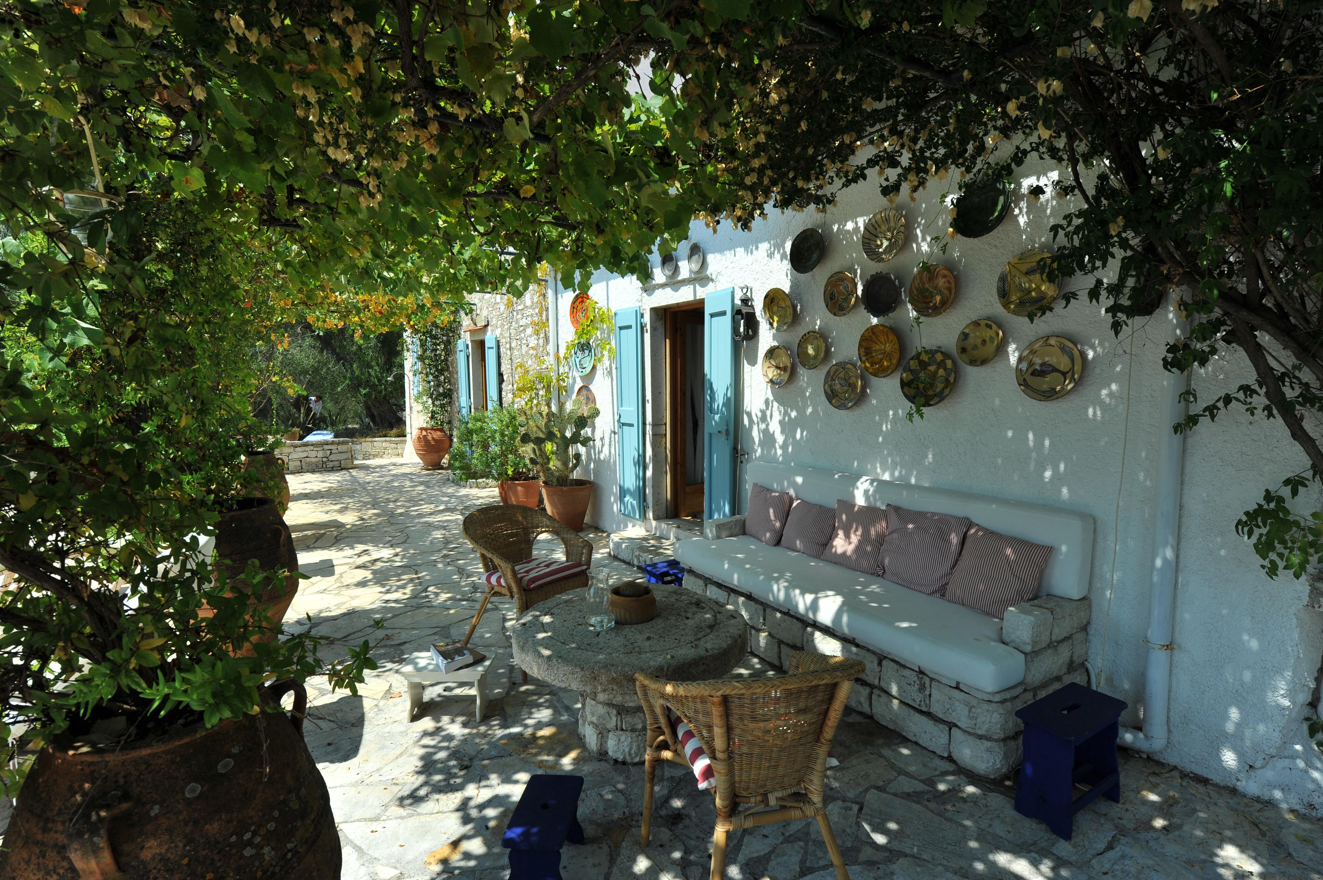 corfu_The_olive_press_agni_pergola_vine_stone_sofa_big_terrace