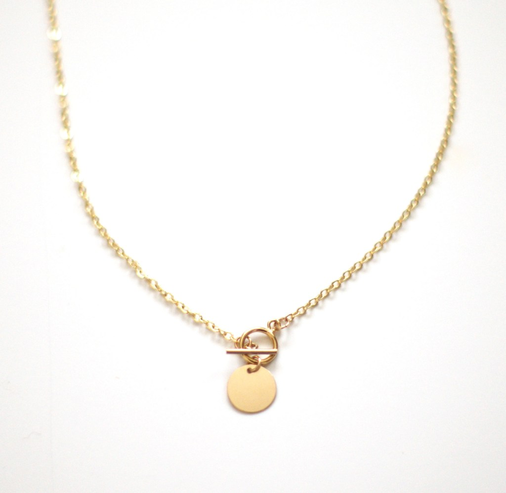 Collier or 18 K T-bar medaillon